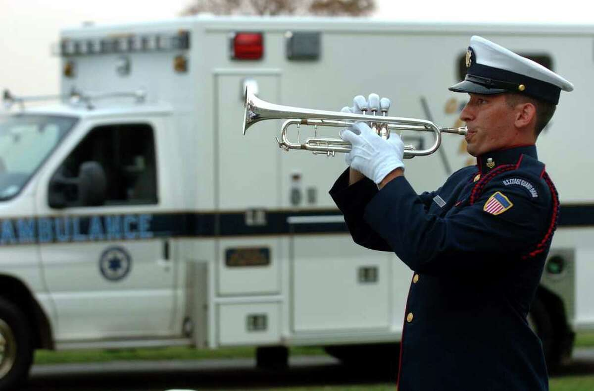 U.S. Coast Guard First Class petty Officer Joel Baroody plays taps as part of a Ceremony Honoring Connecticut's 9/11 First Responders and Volunteers at Sherwood Island State Park in Westport, Conn. on Tuesday September 14, 2011.