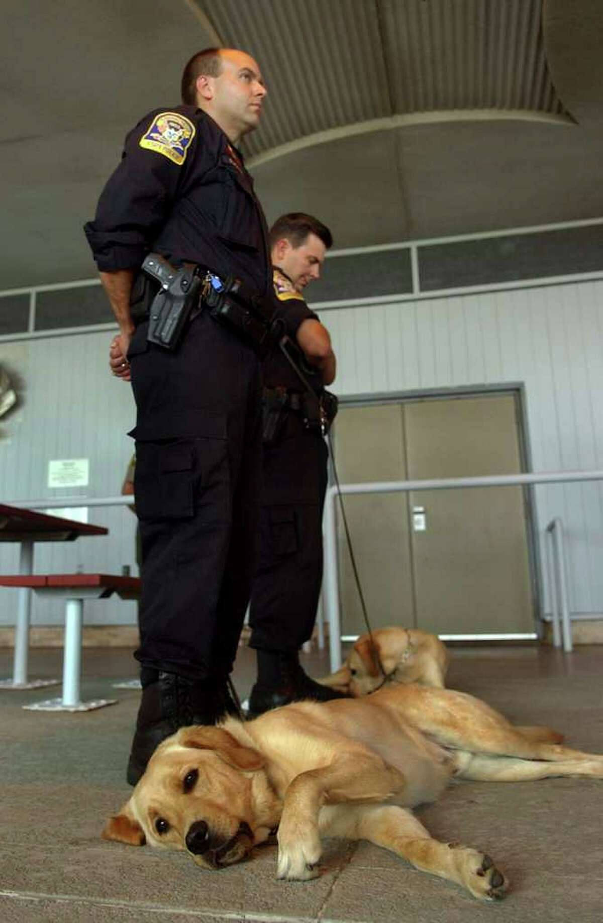 Connecticut State Police K9 Officer Mark Packer stands with his dog Regis, during a Ceremony Honoring Connecticut's 9/11 First Responders and Volunteers at Sherwood Island State Park in Westport, Conn. on Tuesday September 14, 2011.