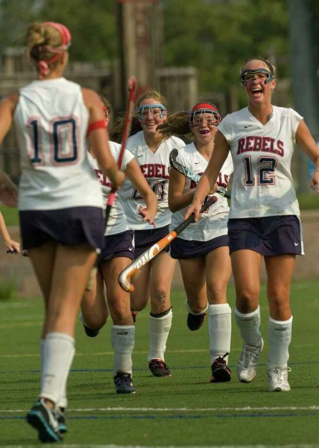 New Fairfield teammates react to Niki VanHouten's, left, penalty stroke goal during their game against New Milford at New Fairfield High School on Wednesday, Sept. 14, 2011. Photo: Jason Rearick / The News-Times