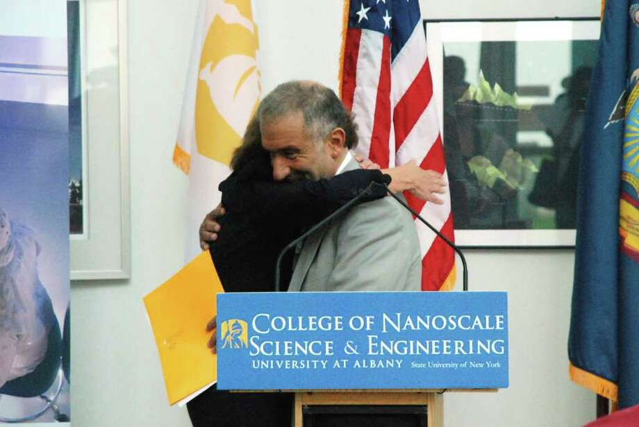 Alain Kaloyeros, senior vice presdient and CEO of the NanoCollege, embraces Judy Vredenburgh, national president and CEO of Girls Inc. at the announcement of a new collaborative initiative at the NanoTech Complex on Wednesday, September 14. (Yi-Ke Peng / Times Union)