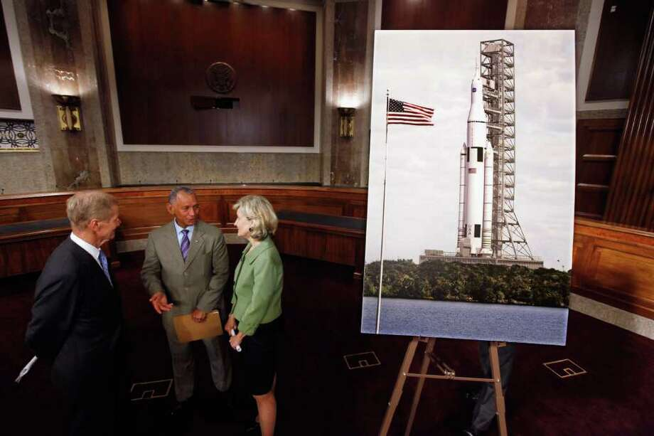 U.S. Sen.  Bill Nelson, left, NASA Administrator Charles Bolden and U.S. Sen.  Kay Bailey Hutchison on Wednesday introduce the design of a rocket to carry U.S. astronauts deep into space. Photo: Chip Somodevilla / 2011 Getty Images