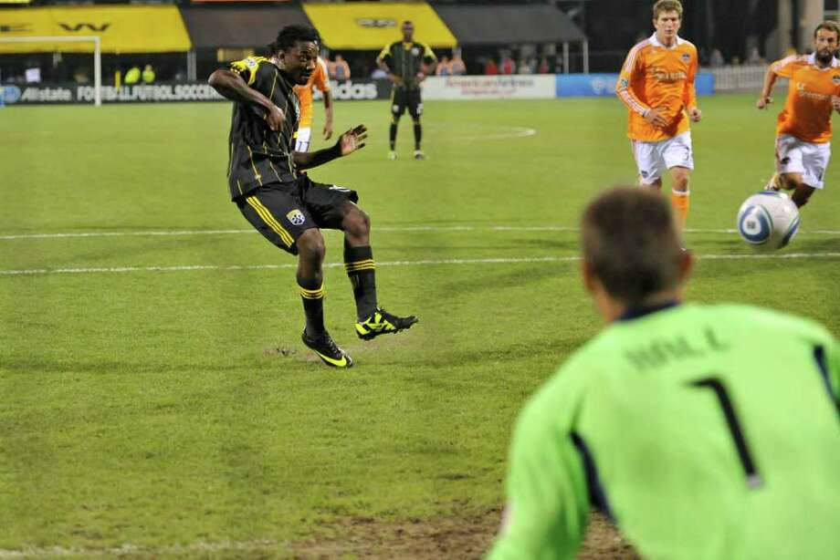 Andres Mendoza of the Columbus Crew scores the first of his two second-half penalty goals on goalkeeper Tally Hall of the Houston Dynamo. Photo: Jamie Sabau, Getty / 2011 Getty Images