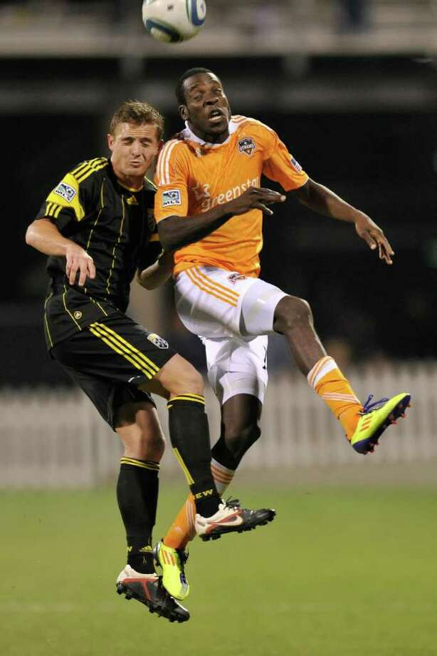 Robbie Rogers of the Columbus Crew and Je-Vaughn Watson of the Houston Dynamo  battle for control of the ball. Photo: Jamie Sabau, Getty / 2011 Getty Images