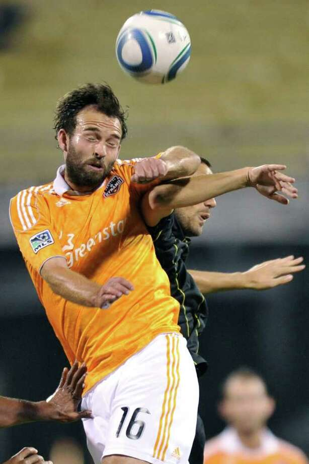 Adam Moffat of the Houston Dynamo gains control of the ball. Photo: Jamie Sabau, Getty / 2011 Getty Images