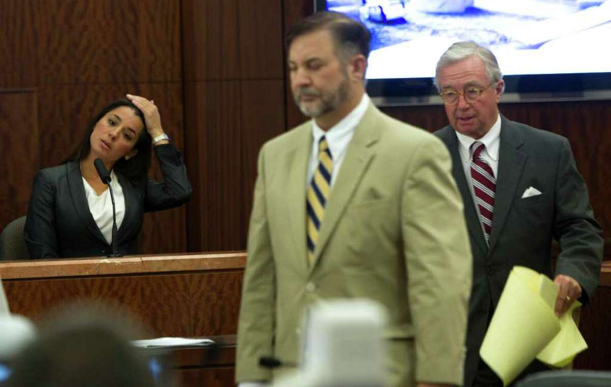 Rachel Brown sits on the stand as her husband, former surgeon Michael Brown, and his attorney Dick DeGuerin, right, take their seats in court Wednesday.