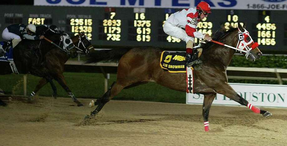 JAMES NIELSEN: CHRONICLE FILE ALL ABOARD: Jockey Jacky Martin, who has ridden at Sam Houston Race Park, broke his neck in a Ruidoso Downs race. Photo: JAMES NIELSEN / HOUSTON CHRONICLE