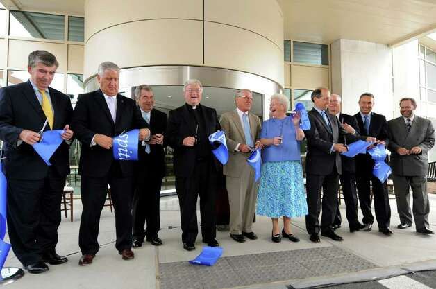 Officials, staff and honored guests enjoy the moment after cutting the ribbon to open the six-story Patient Care Pavilion on Wednesday, Sept. 14, 2011, at St. Peter's Hospital in Albany, N.Y. (Cindy Schultz / Times Union) Photo: Cindy Schultz