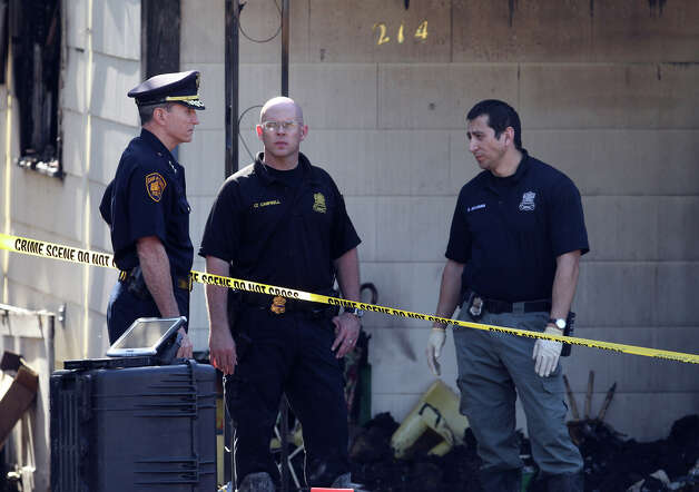 "Police Chief William McManus (left) looks at the scene of a fatal fire in the 200 block of Karen Lane on Wednesday, Sept. 14, 2011. The location is being treated by officials as a crime scene. ""It's tragic what's inside that house,"" McManus said. Photo: John Davenport/jdavenport@express-news.net"