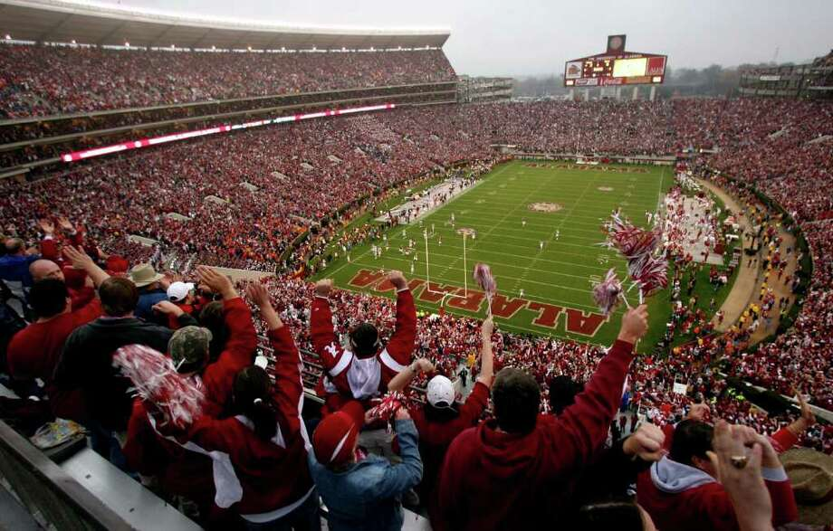 Associated Press file PASSION PLAY: In a league that considers football a religion, it doesn't get any more frenzied than Tuscaloosa for the Alabama-Auburn game. Photo: Robert Sutton / AP2008