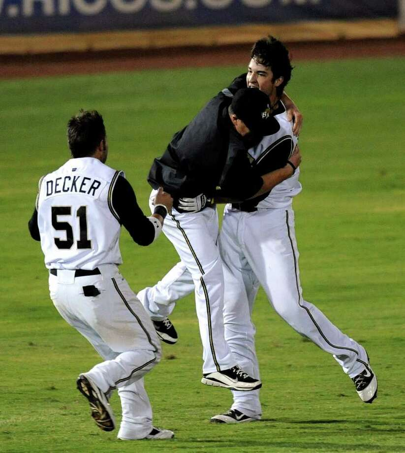 Sawyer Carroll of the San Antonio Missions, right, is embraced by teammates after hitting a walk-off single against Arkansas that ended the 20-inning game two of the Texas League Championship at Wolff Stadium on Wednesday, Sept. 14, 2011. The win puts the Missions one win away from the championship. BILLY CALZADA / gcalzada@express-news.net Photo: BILLY CALZADA, Express-News / gcalzada@express-news.net