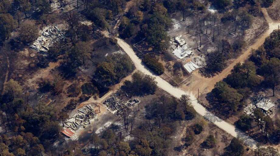 File - Thiis Sept. 7, 2011 file photo shows homes destroyed by a wildfire in Bastrop, Texas. Long before this month's historic wildfires in Texas, the state's forest service came up with a $20.4 million plan to stop the flames from starting or tamp them out before small blazes grew deadly and destructive. Three years later, the plan is still only half-funded. (AP Photo/Eric Gay, File) Photo: Eric Gay / AP2011