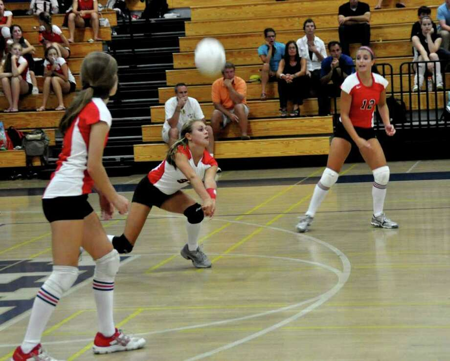 Warde libero Kitty Caissy digs a ball during the Mustangs' 3-0 loss to Staples on Wednesday in Westport. Photo: Contributed Photo