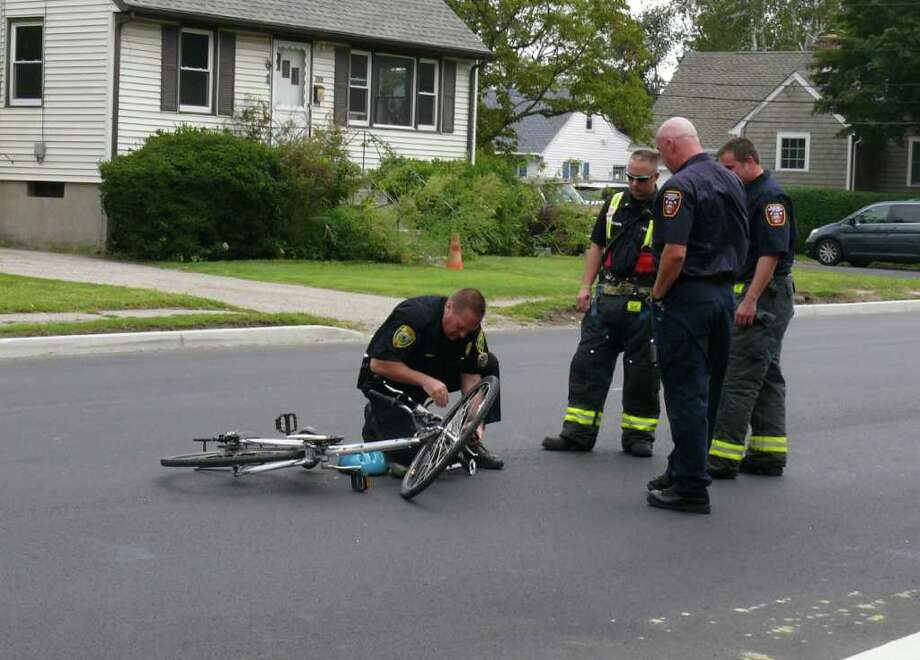 Police and fire at the scene of an accident Thursday that closed Reef Road for short period of time. A bicyclist was apparently hit by the driver of a van in front of Bud's Deli. Photo: Genevieve Reilly / Fairfield Citizen
