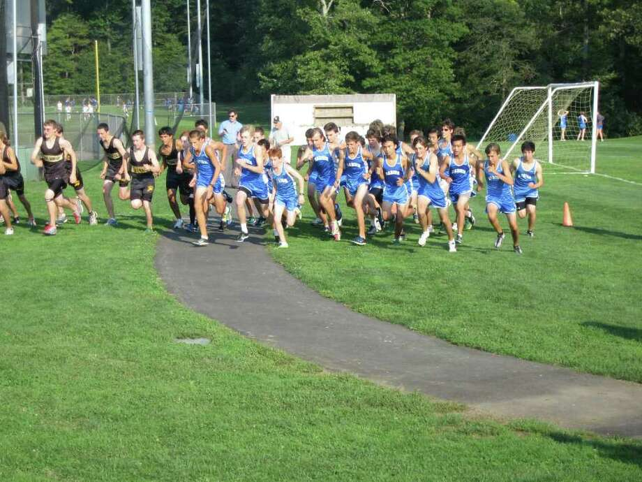 The Darien High School boys cross country team earned its first victories of the season, winning its first dual meet held on Tuesday at Trumbull High School. The Blue Wave defeated Trumbull and Bassick to start the season with a 2-0 mark. Photo: Contributed Photo