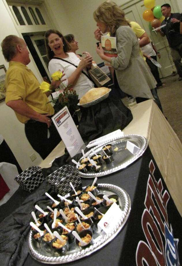 Representatives from Tootie Pie Gourmet Co. serve patrons of the Alamo Heights Chamber of Commerce's 2010 Taste of the Heights. Photo: File Photo