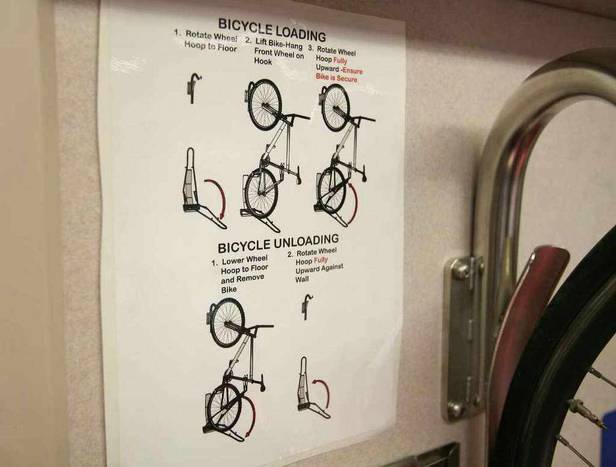 Directions are posted showing the procedure for loading and unloading bikes from the bike racks.
