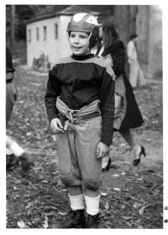 A young Greenwich football player, ca. 1946, is ready to hit the gridiron. Photo: Contributed Photo
