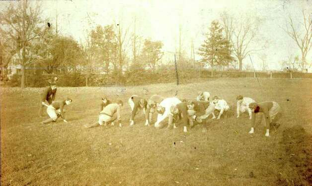 A football team prepares for the snap of the ball on a Greenwich field - back in 1902. Photo: Contributed Photo