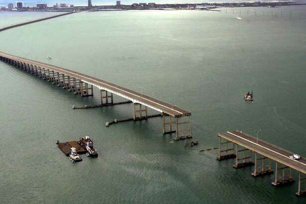 A section of the Queen Isabella Causeway is shown missing as crews survey break from their search and rescue due to an approaching storm in Port Isabell, Texas, Saturday, Sept. 15, 2001. An 80 section of the bridge collapsed when it was struck by a barge early Saturday morning. At least two people were killed and servral others are missing as cars plunged into the water.