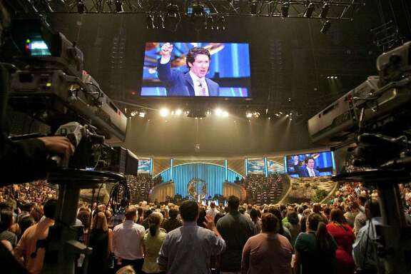 Lakewood Church Pastor Joel Osteen, welcoms his congregation to his 11 a.m. service, Sunday, Aug. 28, 2011, in Houston. Olsteen's non-denominational Christian church, averages about 40,000 people in attendance per week. ( Nick de la Torre / Houston Chronicle )