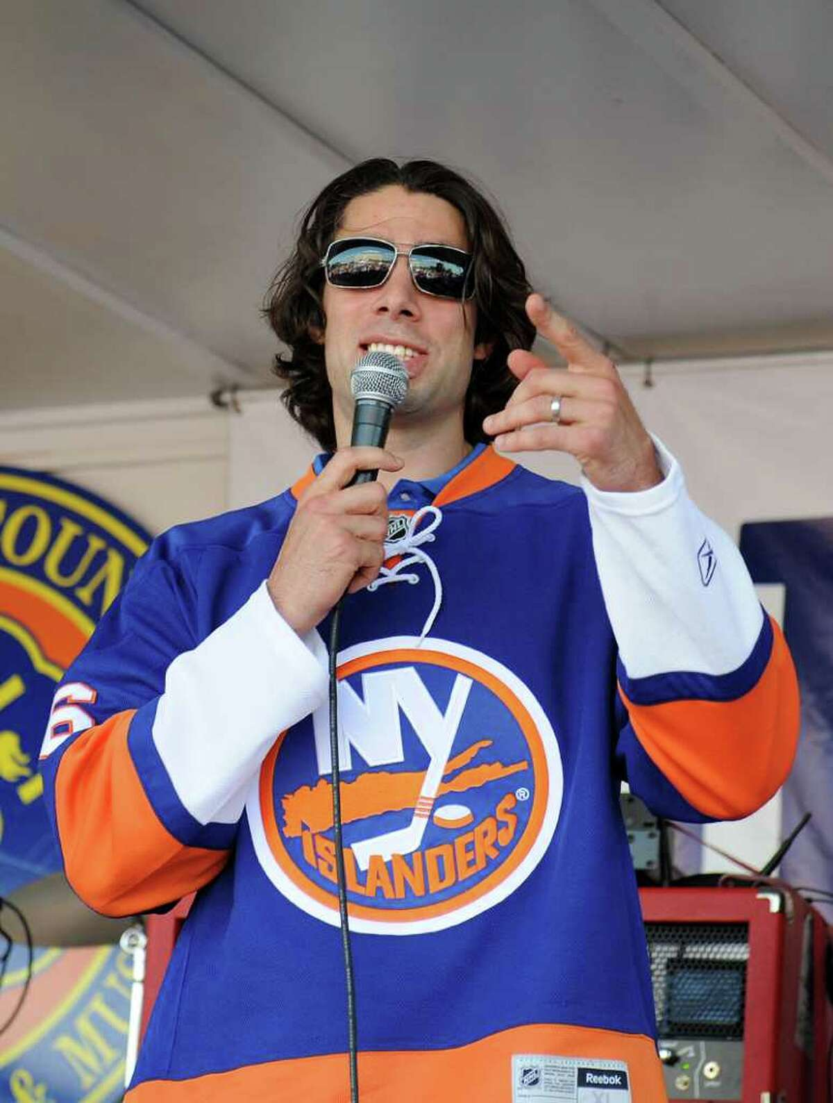 UNIONDALE, NY - JULY 27: Matt Moulson #36 of the New York Islanders speaks during the fan rally at Nassau Coliseum on July 27, 2011 in Uniondale, New York. (Photo by Christopher Pasatieri/Getty Images)