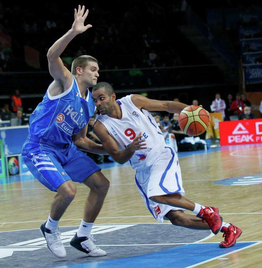 France's Tony Parker, right, challenges for the ball with Greece's Michail Bramos, during their quarter final EuroBasket European Basketball Championship match in Kaunas, Lithuania, Thursday Sept. 15, 2011. Photo: Darko Vojinovic, Darko Vojinovic/Associated Press / AP