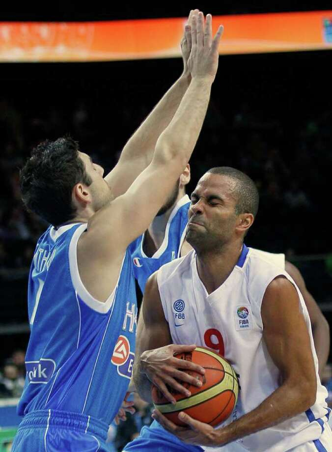 France's Tony Parker, right, challenges for the ball with Greece's Vasileios Xanthopoulos, during their quarterfinal EuroBasket European Basketball Championship match in Kaunas, Lithuania, Thursday, Sept. 15, 2011. Photo: Darko Vojinovic, Darko Vojinovic/Associated Press / AP