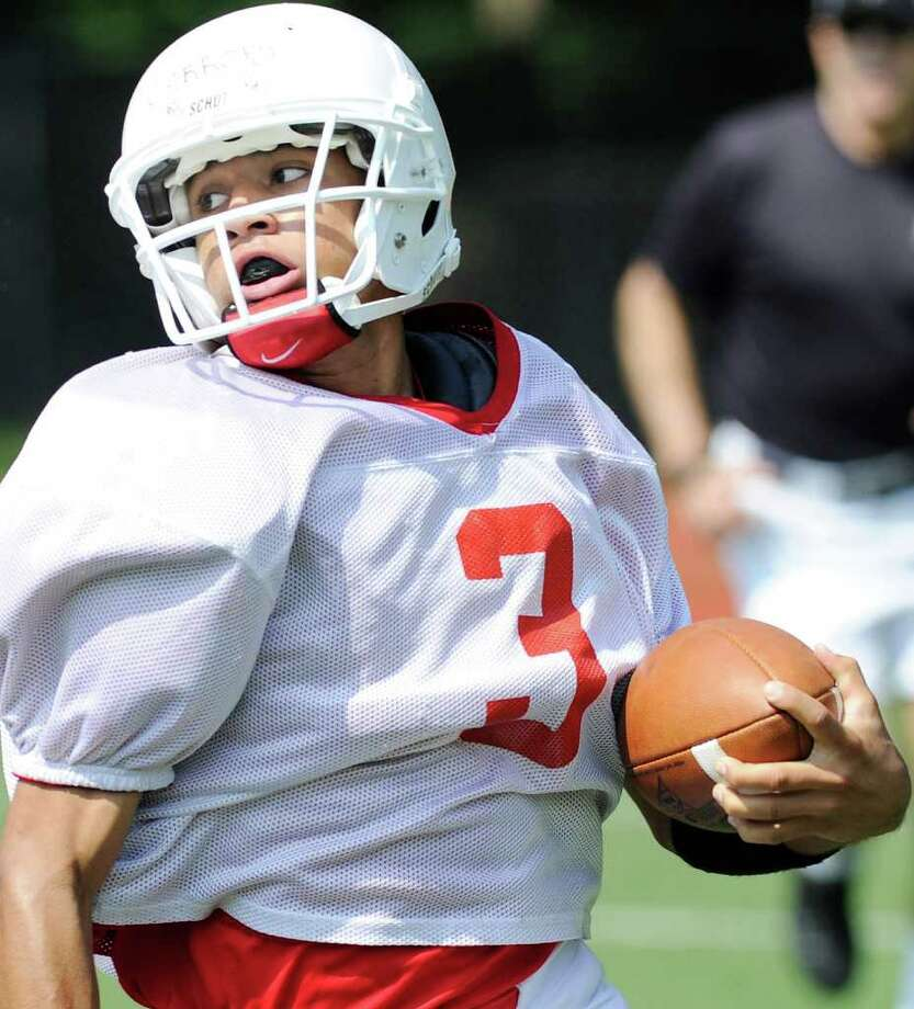 Joel Arroyo, # 3 of the White team, breaks outside for a gain during the Greenwich High School 2011 Red & White annual spring football game at Greenwich High School, Saturday morning, June 18, 2011.  White defeated Red, 14-8. Photo: Bob Luckey / Greenwich Time