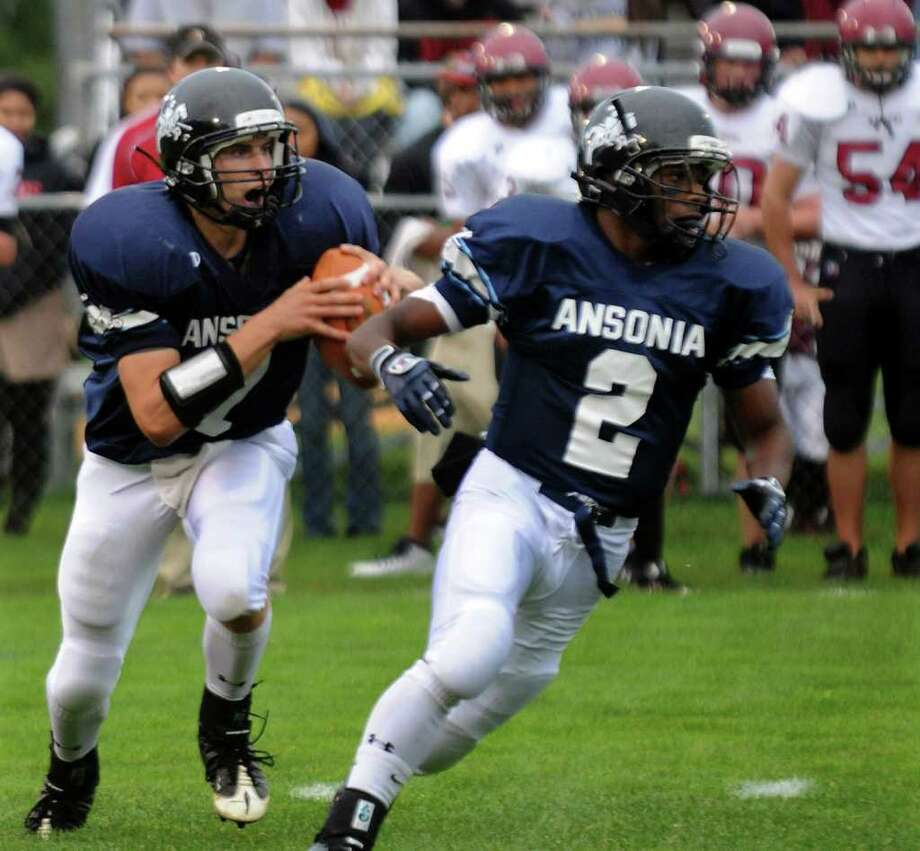 Ansonia QB Elliot Chudwick, left, and #2 Arkeel Newsome during boys football action against Torrington in Ansonia, Conn. on Thursday September 14, 2011. Photo: Christian Abraham / Connecticut Post