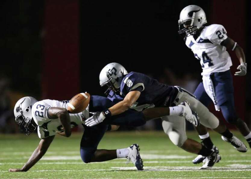 Bryan's Bobby Johnson (23) fumbles after being tackled by College Park's Chris Albores as Bryan's Zi