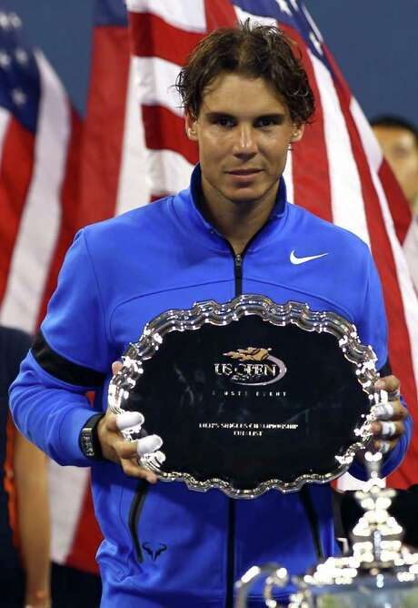 NEW YORK, NY - SEPTEMBER 12:   Rafael Nadal (L) of Spain holds up the runner up award after he lost to Novak Djokovic of Serbia during the Men's Final on Day Fifteen of the 2011 US Open at the USTA Billie Jean King National Tennis Center on September 12, 2011 in the Flushing neighborhood of the Queens borough of New York City.  (Photo by Clive Brunskill/Getty Images) Photo: Clive Brunskill / 2011 Getty Images