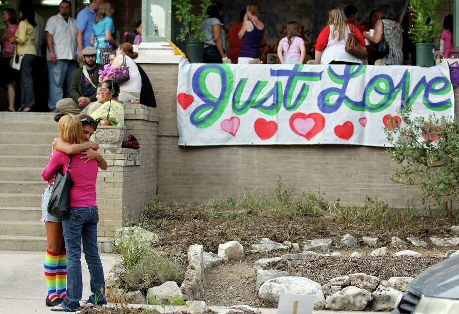"""Rebecca Elizabeth """"Veggie"""" Gonzales' sister Amanda Gonzales (facing camera)  hugs a person attending a vigil at The Circle School. Veggie Gonzales and her daughter were still close to teachers and parents at The Circle School. Photo: Edward A. Ornelas/eaornelas@express-news.net / © SAN ANTONIO EXPRESS-NEWS (NFS)"""