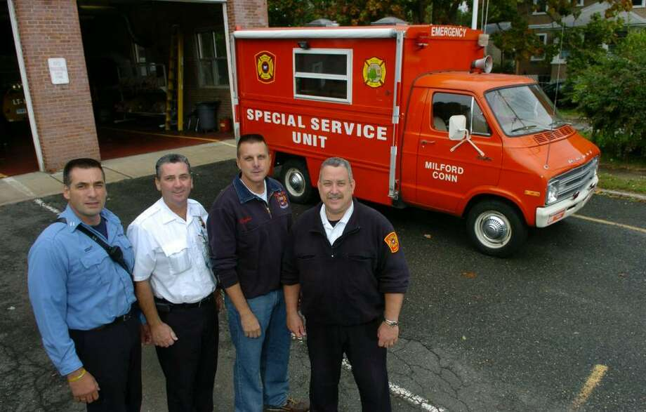 The Milford Fire Department's canteen truck from Fire Station 5 will be headed to Ridgefield FD for their use. Money was raised to purchase the truck by members of the fire explorers back in 1978. Here, several of the members who helped raise the money for the truck, pose at the station in Milford, Conn. on Friday Oct. 09, 2009. From left to right is Capt. Bernie Begley, Inspector Paul Geer, Batalion Chief Patrick Hayden, and Senior Inspector Andy Vargo. Photo: Christian Abraham / Connecticut Post