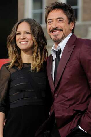 Robert Downey Jr and his wife Susan are expecting their first child together. The baby is due early next year.  Photo: Chris Pizzello, Associated Press / AP2011