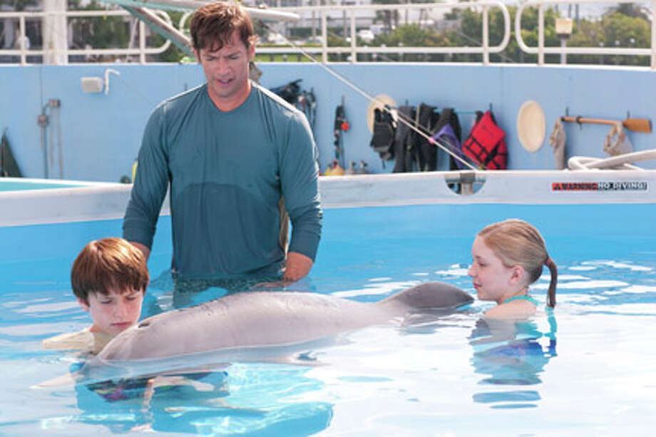 "(L-R) Nathan Gamble as Sawyer Nelson, Harry Connick Jr. as Dr. Clay Haskett and Cozi Zuehlsdorff as Hazel Haskett with Winter in ""Dolphin Tale."" Photo: Jon Farmer / ©2011 Alcon Film Fund LLC."