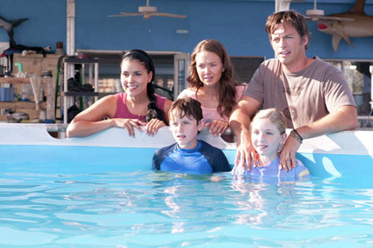 (L-R) Juliana Harkavy as Rebecca, Nathan Gamble as Sawyer Nelson, Austin Highsmith as Phoebe, Cozi Zuehlsdorff as Hazel Haskett and Harry Connick Jr. as Dr. Clay Haskett in