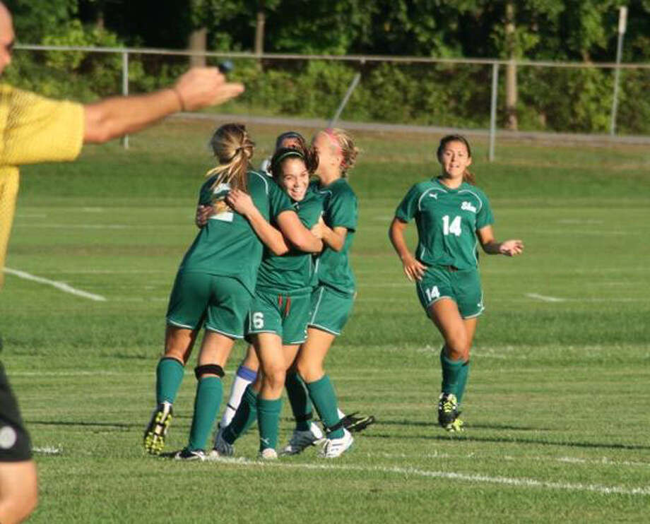 Laura Goodman Cavanaugh Jaclyn Romano, wearing jersey No. 6, and her teammates celebrate her game-winning goal in overtime last Friday against Saratoga. It was Romano?s first game on the school?s varsity soccer team.