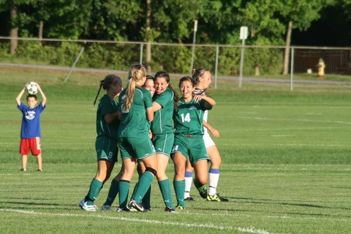 Laura Goodman Cavanaugh Jaclyn Romano is mobbed by teammates after her game-winning goal in overtime last Friday against Saratoga.