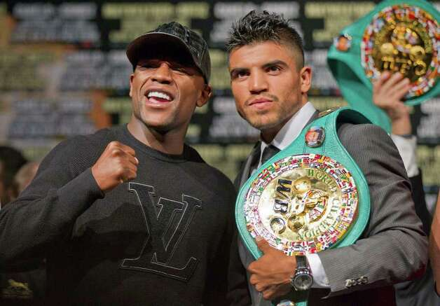 Floyd Mayweather, left, and Victor Ortiz square off for a photo after a boxing news conference, Wednesday, Sept. 14, 2011, in Las Vegas. The pair are slated to fight for Oritz' WBC welterweight title on Saturday, Sept. 17. Photo: AP