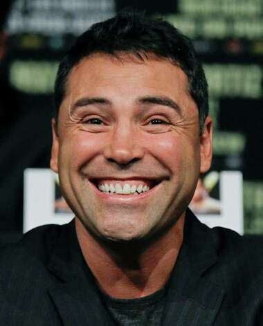 Oscar De La Hoya reacts during a boxing news conference previewing the Floyd Mayweather vs. Victor Ortiz fight, Wednesday, Sept. 14, 2011, in Las Vegas.  Ortiz is slated to defend his WBC welterweight title against Mayweather on Saturday, Sept. 17. Photo: AP