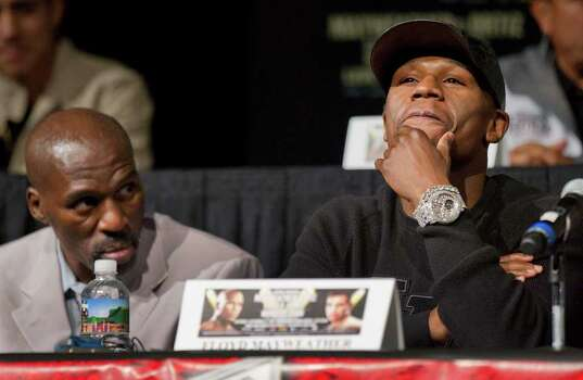 Floyd Mayweather, right, listens to comments along with his trainer and uncle, Roger Mayweather, left, during a boxing news conference, Wednesday, Sept. 14, 2011, in Las Vegas. Mayweather is slated to challenge Victor Ortiz for his WBC welterweight title on Saturday, Sept. 17. Photo: AP