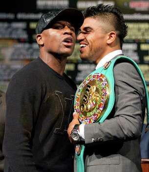 Floyd Mayweather, left, and Victor Ortiz talk while posing for a photo after a news conference Wednesday, Sept. 14, 2011, in Las Vegas. Mayweather and Ortiz are scheduled to box for Ortiz's WBC welterweight title Saturday. Photo: AP