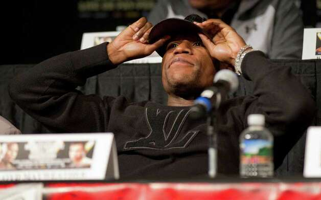 Floyd Mayweather listens during a boxing news conference, Wednesday, Sept. 14, 2011, in Las Vegas. Mayweather is slated to challenge Victor Ortiz for his WBC welterweight title on Saturday, Sept. 17. Photo: AP