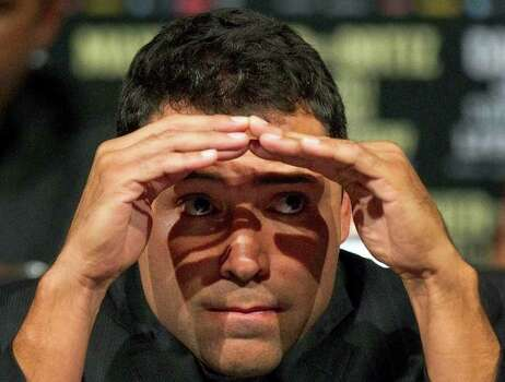 Oscar De La Hoya looks for friends in the audience during a boxing news conference previewing the Floyd Mayweather vs. Victor Ortiz fight, Wednesday, Sept. 14, 2011, in Las Vegas.  Ortiz is slated to defend his WBC welterweight title against Mayweather on Saturday, Sept. 17. Photo: AP