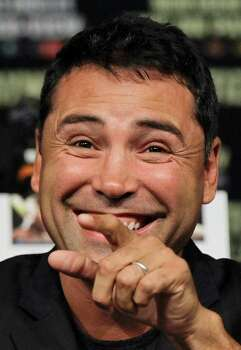 Oscar De La Hoya points to a friend in the audience during a boxing news conference previewing the Floyd Mayweather vs. Victor Ortiz fight, Wednesday, Sept. 14, 2011, in Las Vegas.  Ortiz is slated to defend his WBC welterweight title against Mayweather on Saturday, Sept. 17. Photo: AP