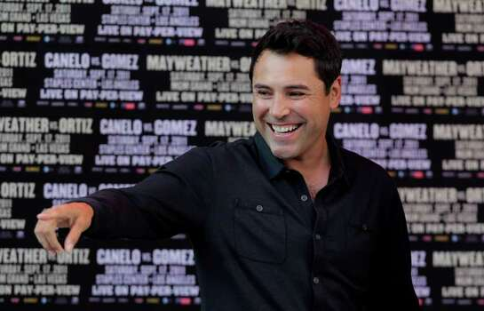 Boxing promoter and former boxing champion Oscar De La Hoya points toward the crowd during a media event for Floyd Mayweather Jr. and Victor Ortiz at CityWalk  in Universal City, Calif., Monday, Sept. 12, 2011. Mayweather Jr. and Ortiz will fight in a WBC welterweight title match, Saturday in Las Vegas. Photo: AP