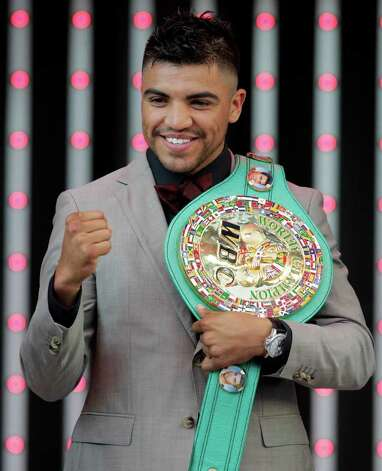 Boxer Victor Ortiz poses with his championship belt at CityWalk in Universal City, Calif., Monday, Sept. 12, 2011. Ortiz is scheduled to face Floyd Mayweather in a WBC welterweight title match Saturday in Las Vegas. Photo: AP