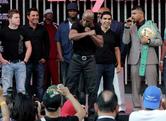 Floyd Mayweather, center, poses for photos as he is joined by, in back from left, boxer Canelo Alvarez, of Mexico; Oscar De La Hoya; rapper 50 Cent; and Victor Ortiz, right, at CityWalk in Universal City, Calif., Monday, Sept. 12, 2011. Mayweather is scheduled to face Ortiz in a WBC welterweight boxing title match Saturday in Las Vegas. Photo: AP