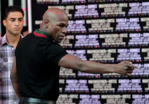 Floyd Mayweather gestures toward the crowd while posing for photos at CityWalk in Universal City, Calif., Monday, Sept. 12, 2011. Mayweather is scheduled to fight champion Victor Ortiz in a WBC welterweight title match  Saturday in Las Vegas. Photo: AP