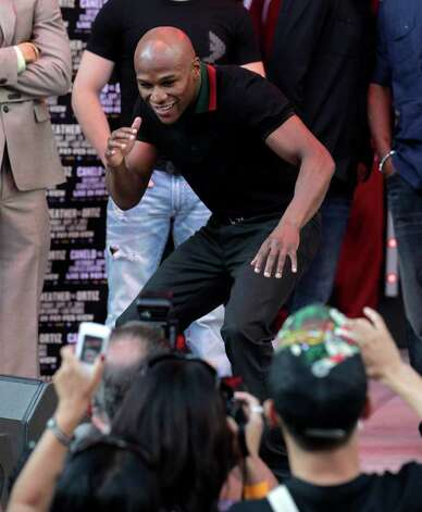 Boxer Floyd Mayweather Jr. poses for photos at CityWalk in Universal City, Calif., Monday, Sept. 12, 2011. Mayweather Jr. will fight champion Victor Ortiz in a WBC welterweight title match, Saturday in Las Vegas. Photo: AP
